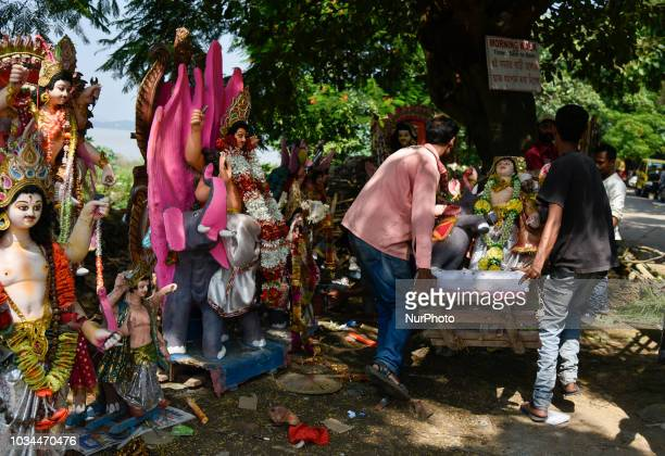 People keep old Lord Vishwakarma idol in the bank Brahmaputra river as Vishwakarma puja tomorrow and new idol to bought for puja in Guwahati Assam...