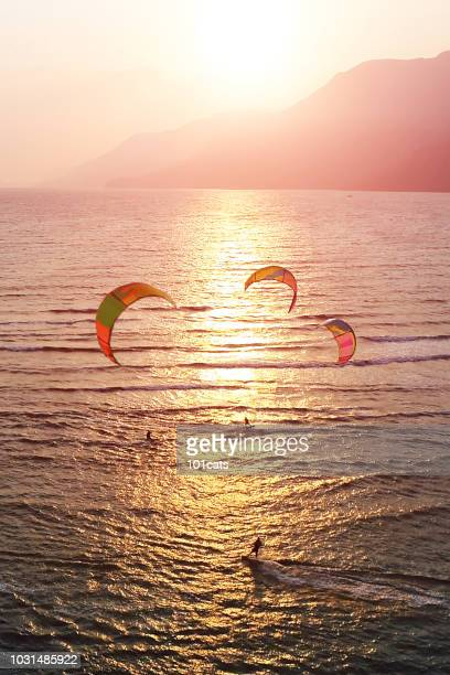 people kitesurfing in the sun
