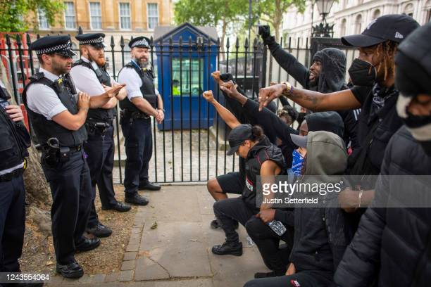 People kneel in front of police during a Black Lives Matter protest at Hyde Park on June 03 2020 in London England The death of an AfricanAmerican...