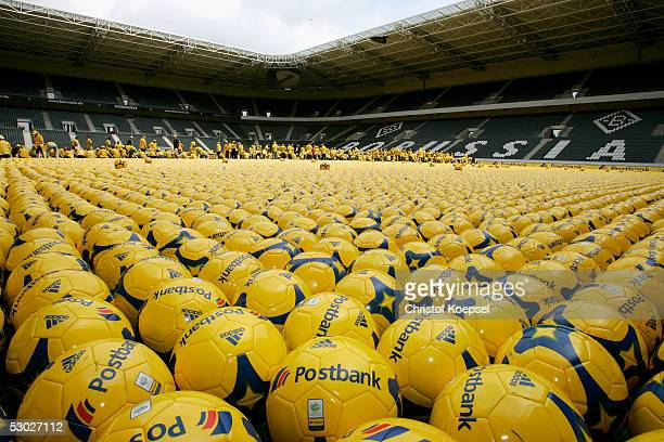 320 people laid down 142000 ball to break a new guinness record on the football ground of Borussia Moenchengladbach in the Borussiapark before the...