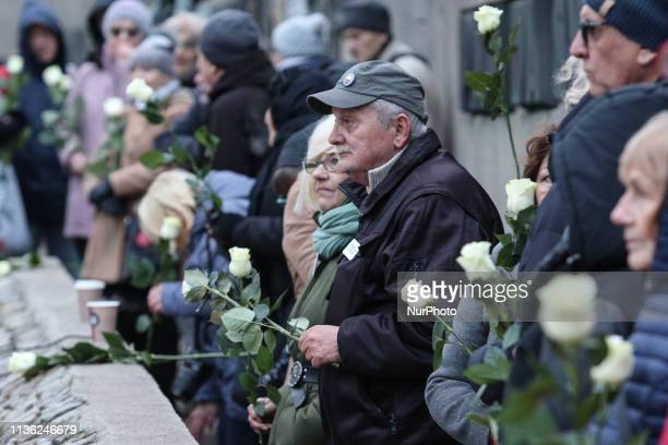 People laid white roses and candles on the wall of the Solidarity Square in Gdansk Poland on 10 April 2019 to commemorate 96 fallen in the plane...