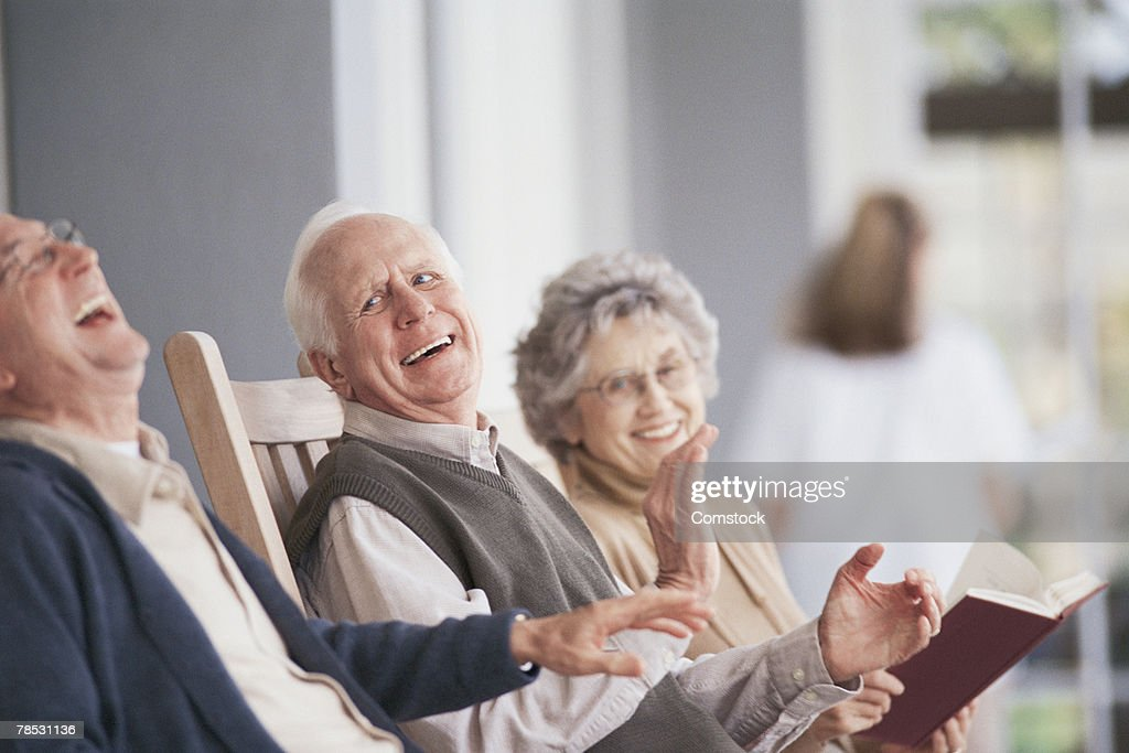 People laughing on porch : Stock Photo