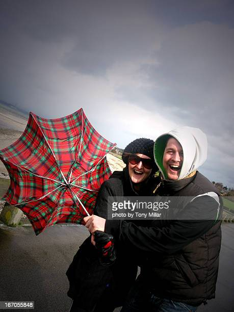 people laughing with umbrella - inside out stock pictures, royalty-free photos & images