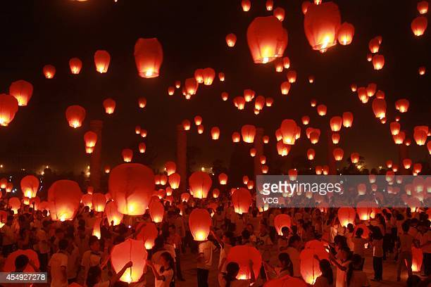 People launch Kongming laterns in celebration of the Midautumn Festival on September 7 2014 in Yichun Jiangxi Province of China These laterns were...