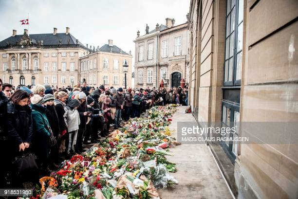 People lay down flowers in front of Amalienborg Palace in Copenhagen Denmark on February 15 2018 after His Royal Highness Prince Henrik died on...