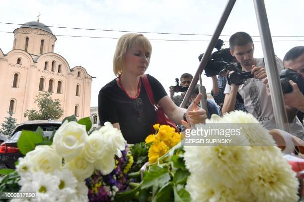 People lay flowers and light candles at Dutch embassy in Kiev on July 17 to remember those killed on flight MH17 four years ago when the plane was...