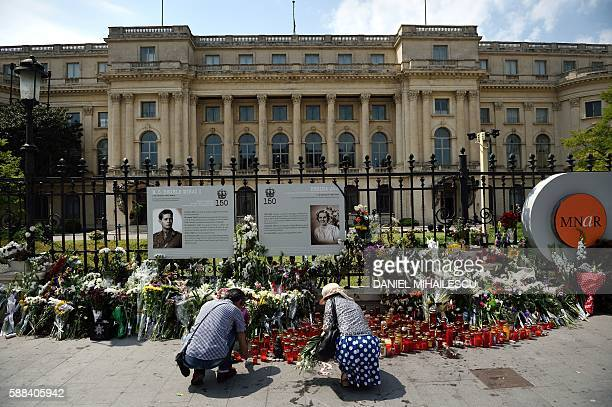 People lay flowers and light candles in the memory of the late Queen Anne of Romania at the Royal Palace now The Art Museum of Romania in Bucharest...