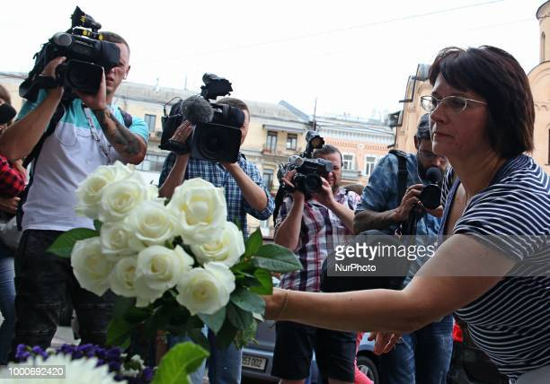 People lay flowers and toys in front of the Embassy of Netherlands on July 17 2018 Ukraine mourns the victims of MH17 civil aviation board which was...