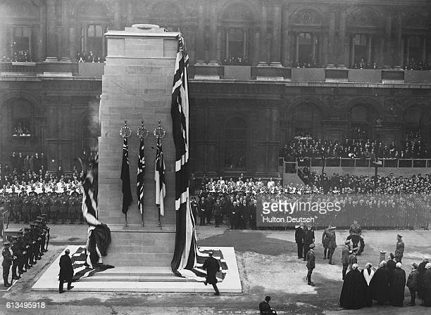 People lay flowers and wreaths at the cenotaph in London.