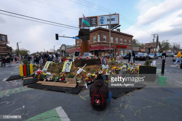 People lay flowers at a memorial in George Floyd Square in Minneapolis, Minnesota, United States on April 21, 2021. George Floyd by the Cup Foods...