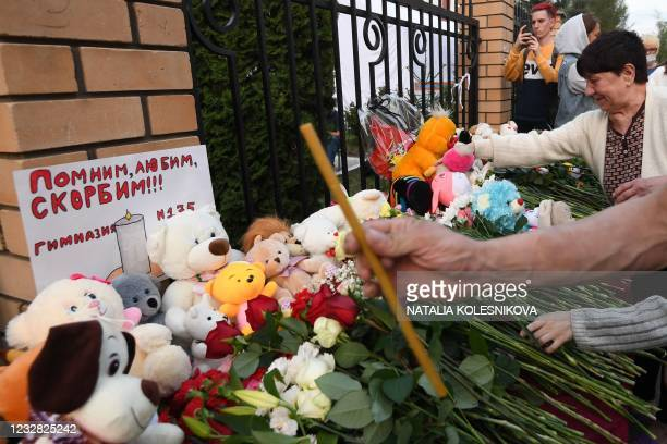 People lay flowers, candles and toys at a makeshift memorial for victims of the shooting at School No. 175 in Kazan on May 11, 2021. - At least nine...