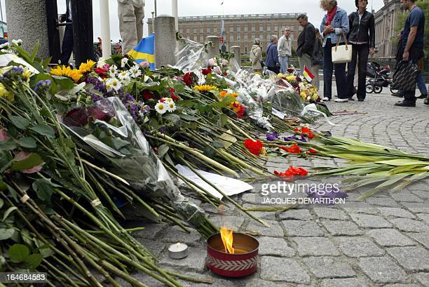 People lay flowers in front Sweden's foreign minister Anna Lindh's ministry office 12 September 2003 in Stockholm The Swedish people mourn their...