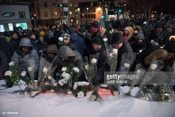 TOPSHOT People lay flowers in memory of the victims near the Islamic Cultural Center in Quebec City Canada on January 29 2018 On January 29 just...