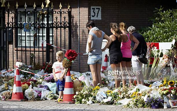 People lay flowers in memory of the victims of Malaysia Airlines flight MH17 at the Korporaal van Oudheusdenkazerne in Hilversum where the...