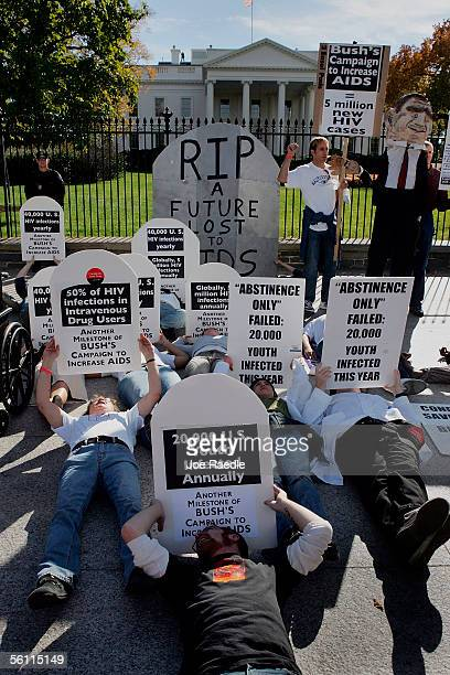 People lay on the ground in front of the White House during a protest against President George W Bush's administration and its handling of HIV...