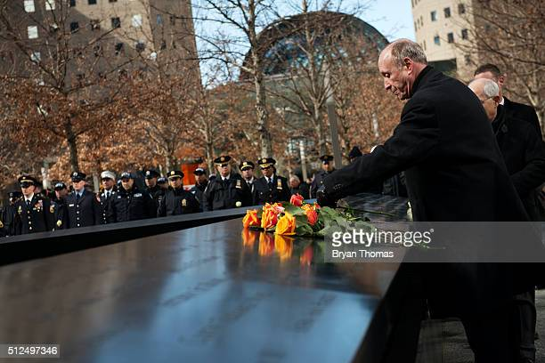 People lay roses on the 9/11 Memorial on the 23rd Anniversary of the 1993 World Trade Center bombing on February 26 2016 in New York NY On the the...