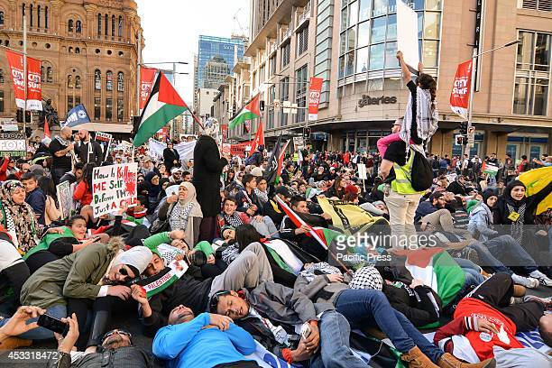 People laying on the street as a way of protest during a march against Israel's military incursions in Gaza Palestine supporters and sympathizers...