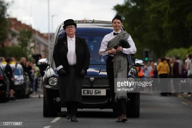 People lead Jack Charlton's funeral cortege as it passes through his childhood home town on July 21 2020 in Ashington Northumberland England John...
