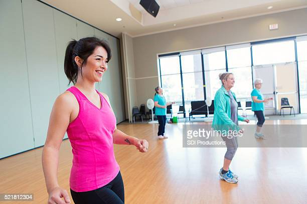 People learn line dancing at community center