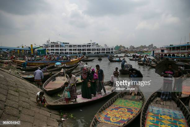 People leave a boat on the Buriganga river on June 4 2018 in Dhaka Bangladesh Bangladesh has been reportedly ranked 10th out of the top 20 plastic...