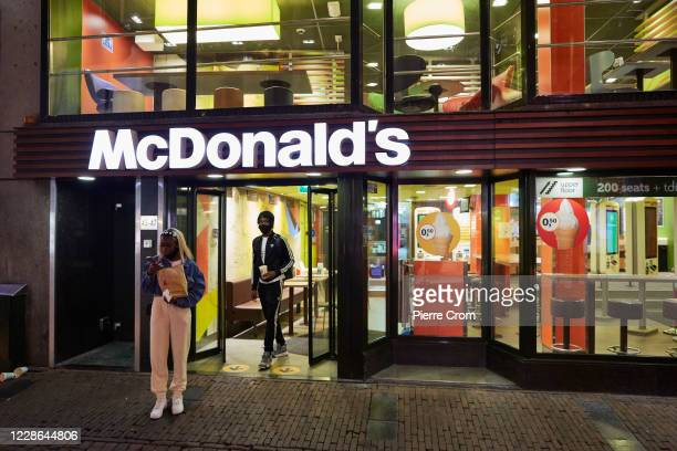 People leave a McDonald's restaurant on September 21, 2020 in Amsterdam, Netherlands. Due to the rapid rise in new Coronavirus cases, Dutch...
