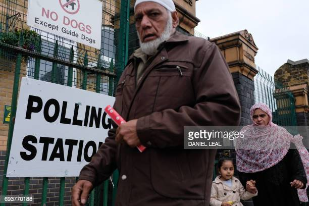 People leave a polling station in Ilford east London on June 8 as Britain holds a general election As polling stations across Britain open on...