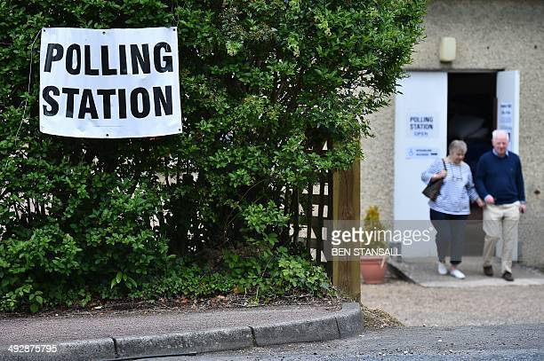 People leave a polling station in Royal Tunbridge Wells south of London on May 22 2014 Europe's mammoth parliamentary elections kicked off on...