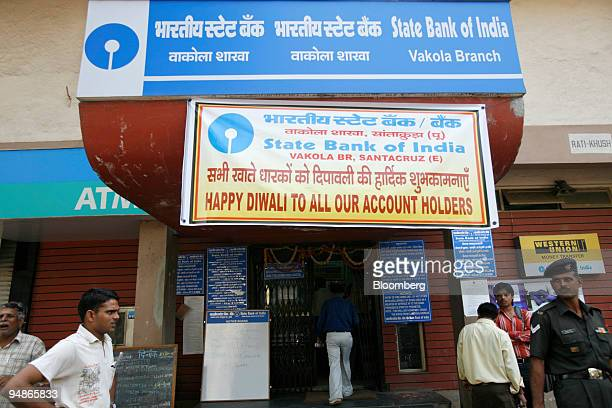 People leave a State Bank of India branch in Mumbai India on Monday Oct 27 2008 State Bank of India the nation's biggest by assets reported a 40...
