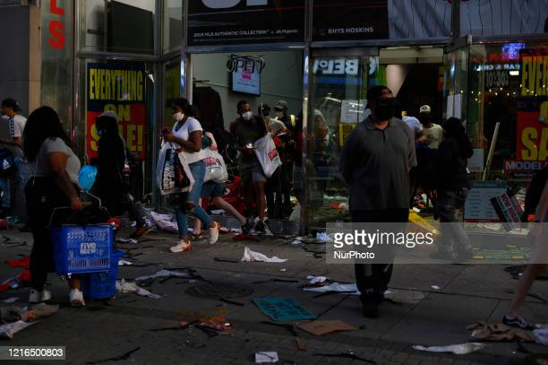 People leave a store on Walnut Street in Philadelphia PA on May 30 2020 Protestors clash with police in cities around the nation when thousands take...