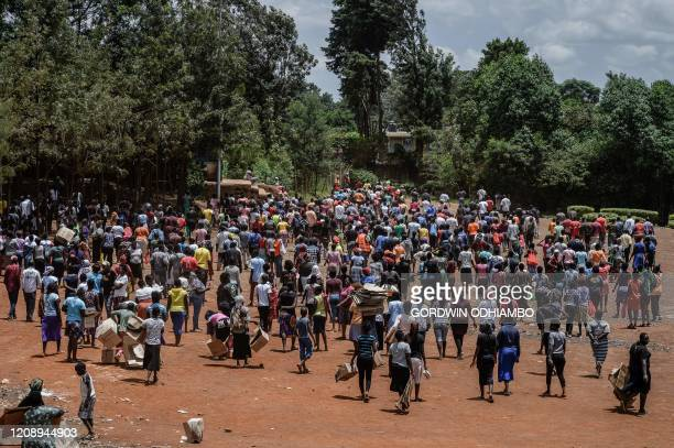People leave after a food distribution by Team Pangaj a Kenyan voluntary group delivering flour beans milk and juice for about 900 people at the...