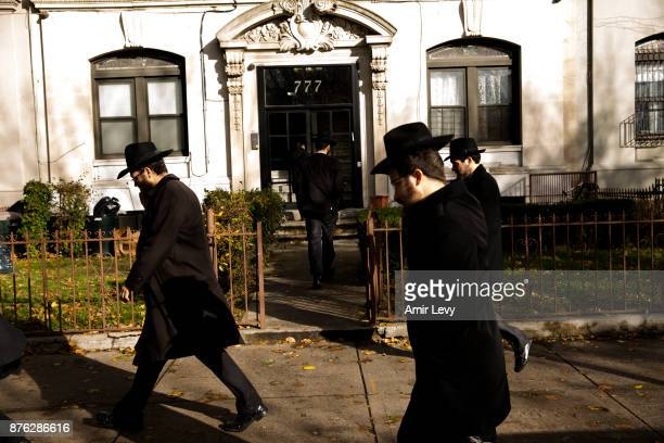 People leave after a group photo part of the annual International Conference of ChabadLubavitch Emissaries in front of Chabad Lubavitch World...