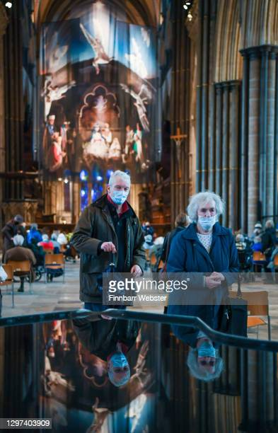 People leave after getting the Pfizer Covid vaccine at the vaccination centre set up inside Salisbury Cathedral on January 20, 2021 in Salisbury,...