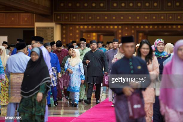 People leave after listening Brunei's Sultan Hassanal Bolkiah's speech during an event in Bandar Seri Begawan on April 3 2019 Brunei's sultan called...