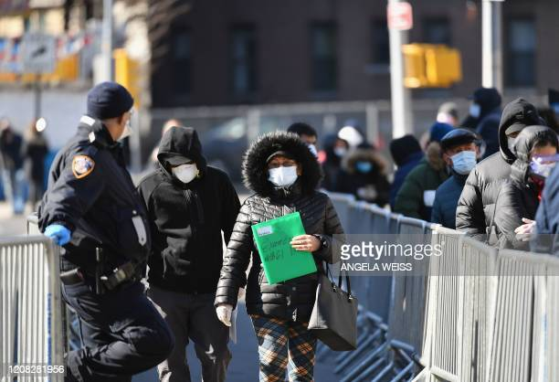 People leave after they were tested for the coronavirus at Elmhurst Hospital Center in the Queens borough of New York City on March 26 2020 Elmhurst...