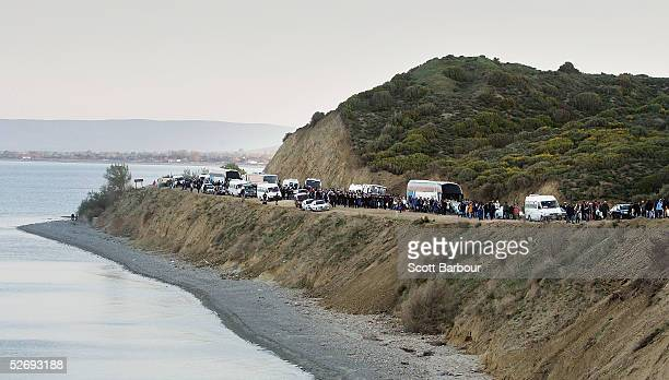 People leave Anzac Cove along the newly constructed road after attending the dawn ceremony to mark the 90th anniversary of the landing of soldiers on...