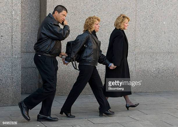 People leave federal court after Bernard Madoff founder of Bernard L Madoff Investment Securities LLC pled guilty in New York US on Thursday March 12...