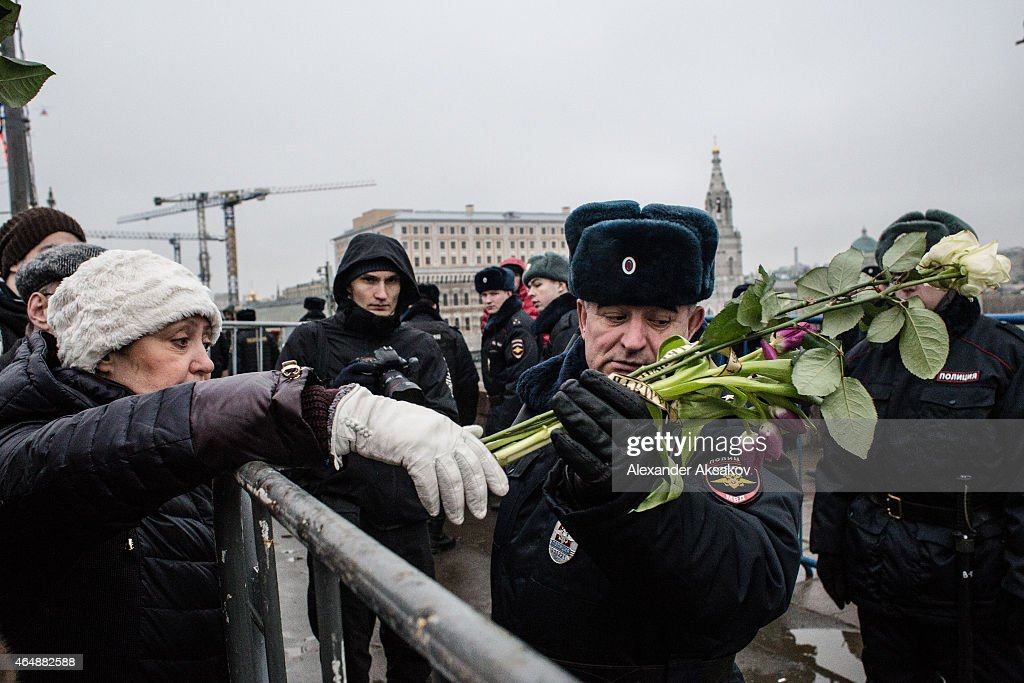 People leave flowers at a march in memory of Russian opposition leader and former Deputy Prime Minister Boris Nemtsov on March 01, 2015 in central Moscow, Russia. Nemtsov was murdered on Bolshoi Moskvoretsky bridge near St. Basil cathedral just few steps from the Kremlin on February 27. Nemtsov, a fierce critic of President Vladimir Putin, was shot dead ahead of a major opposition rally this weekend.