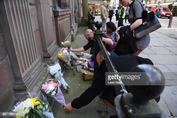 People leave flowers in St Anne's Square on May 23 2017 in Manchester England Prime Minister Theresa May held a COBRA meeting this morning following...