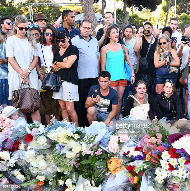 People leave flowers to various places of the city for the victims of the Nice terror attack in Nice France on July 15 2016