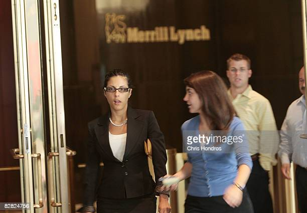 People leave Merrill Lynch's offices in the World Financial Center September 15 2008 in New York City Bank of America Corp the largest US consumer...