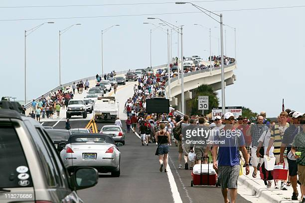 People leave the A. Max Brewer Memorial Parkway Bridge after the launch of space shuttle Endeavour was scrubbed, Friday, April 29 in Titusville,...