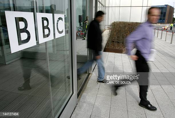 People leave the BBC building in the corporation's West London headquarters 21 March 2005 The BBC is to axe 2050 jobs in a second wave of cuts to...