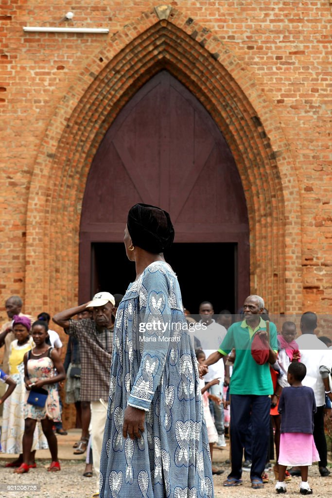 People leave the church at the end of Sunday mass in Mbalmayo (village south Yaounde) on February 18, 2018 in Yaounde, Cameroon. Cameroon is often referred to as 'Africa in miniature' for its geological and cultural diversity. Natural features include beaches, deserts, mountains, rainforests, and savannas.