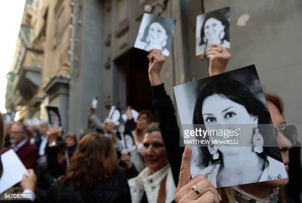 People leave the church of St Francis after the Archbishop of Malta celebrated mass in memory of murdered journalist Daphne Caruana Galizia on the...