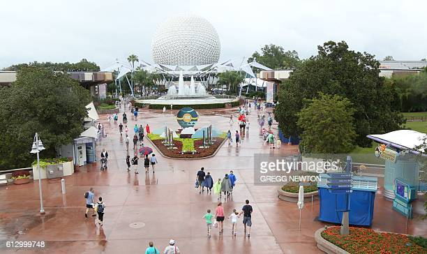 People leave the Epcot center after it closed in Orlando Florida in preparation for the landfall of Hurricane Matthew on October 6 2016 Some three...