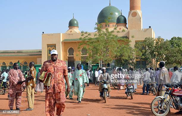 People leave the Grand Mosque of Niamey on May 1 after a collective prayer for the victims of an attack by Boko Haram Islamists on Karamga island on...