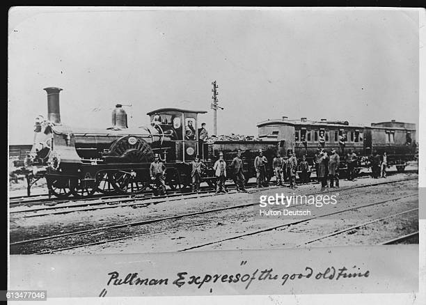 People leave the Pullman Express steam locomotive and begin walking across the railroad tracks