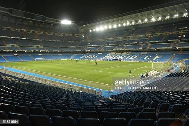 People leave the stadium after a bomb alert during the Premier League football match between Real Madrid and Real Sociedad in Santiago Bernabeu...