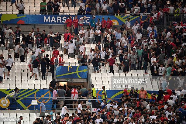 People leave the stadium following clashes between Russian and English supporters at the end of the Euro 2016 group B football match between England...