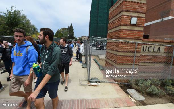 People leave the University of California Los Angeles campus after a shooting on the facility June 1 in Los Angeles California Two people were...